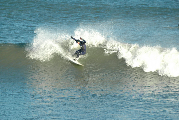 Surf like a girl in the Winter!  Ana prefers the tropics but still throws down big slashing turns on cold RI winter waves!